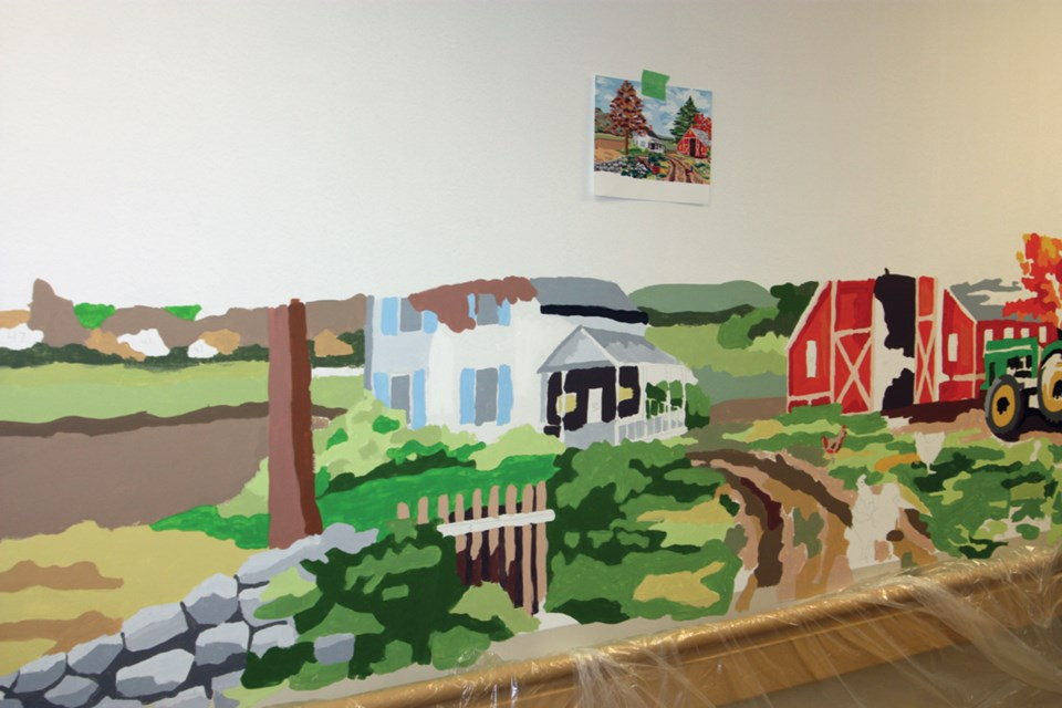 Residents at the Continuing Care Centre in Westlock have been teaming up with local home-schooling students to create a mural on one of the walls of the facility. chris zwick/WN