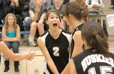 Madison Chamzuk (c) shows a little excitement with her Boyle Husky teammates after scoring a point in Friday night's senior girl's volleyball match against the