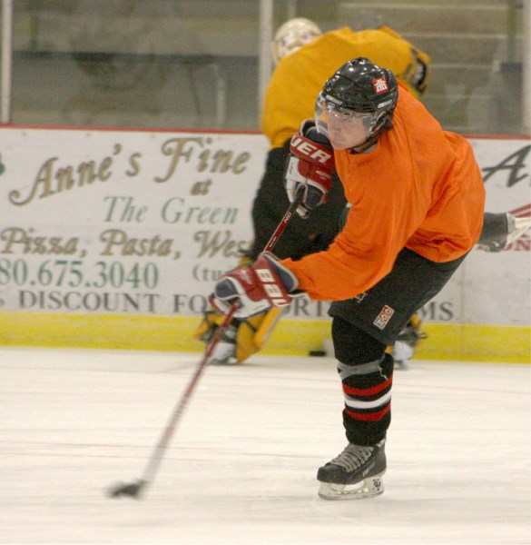Athabasca Ace Jody Tangedal rips the puck on net during tryouts in late September.