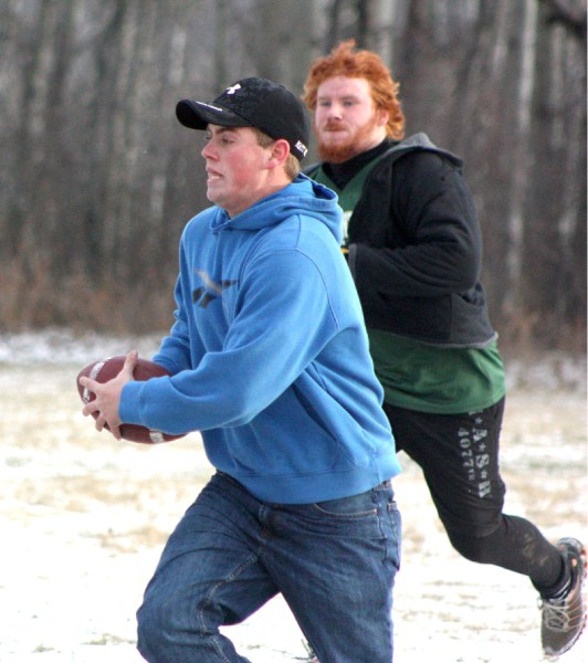 Former EPC Pacer Mat Smith (front) runs away from Travis Koster in a pick-up game of touch football at the Pacers wrap-up party last Wednesday evening at EPC school.