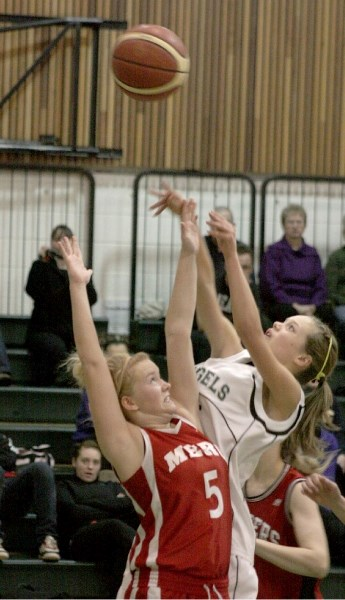 EPC Senior Angel Jackie Elgert takes a shot over a Fort McMurray Trapper during the fourth quarter of the bronze medal match in a tournament hosted by Athabasca. The Angels
