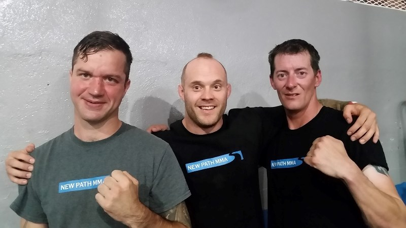 Geoff Loken (left) and Kolt Nahirney (right) stand with New Path MMA owner, operator and fighter Josh Kitchen were in Taber for Loken and Nahirney's first fight.