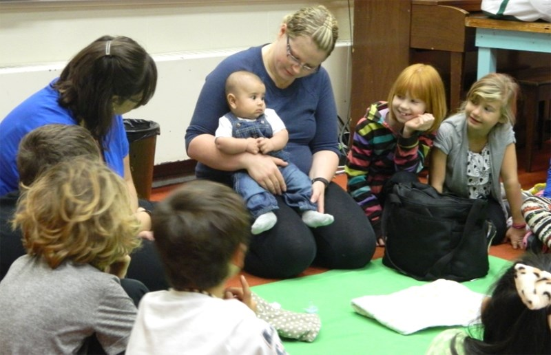 Roots instructor Tamara Hubscher with mom Nikki Cabral and her son Ian during a session at BES in 2016. Student Adriana Parker (red head) and Kaylan Hiemstra (blonde)