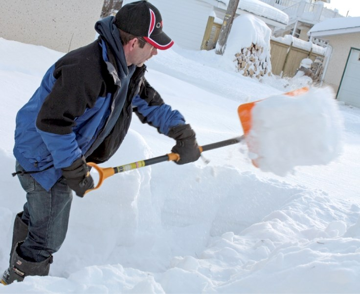 Miles White shovels out his daughter's backyard on Jan. 18. White was digging out after the big snow dump the town received over the previous weekend.