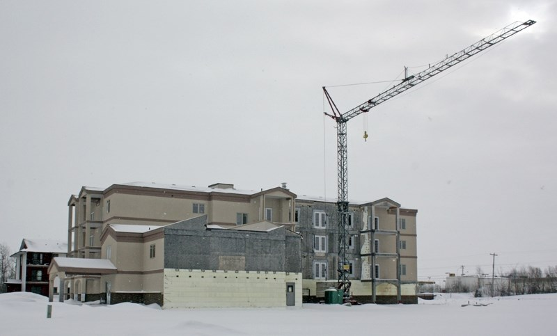 This unfinished condominium started by Melvac Construction, which went bankrupt before it completed the project, sits unfinished near the McDonald's. A group of local