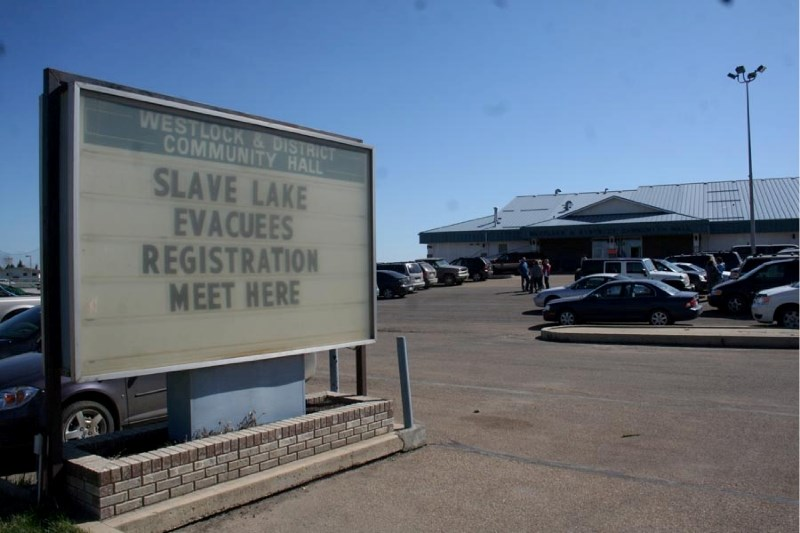 A sign outside of the Westlock and District Community Hall directs evacuees from the Slave Lake area to the temporary shelter set up inside. Westlock hosted several hundred
