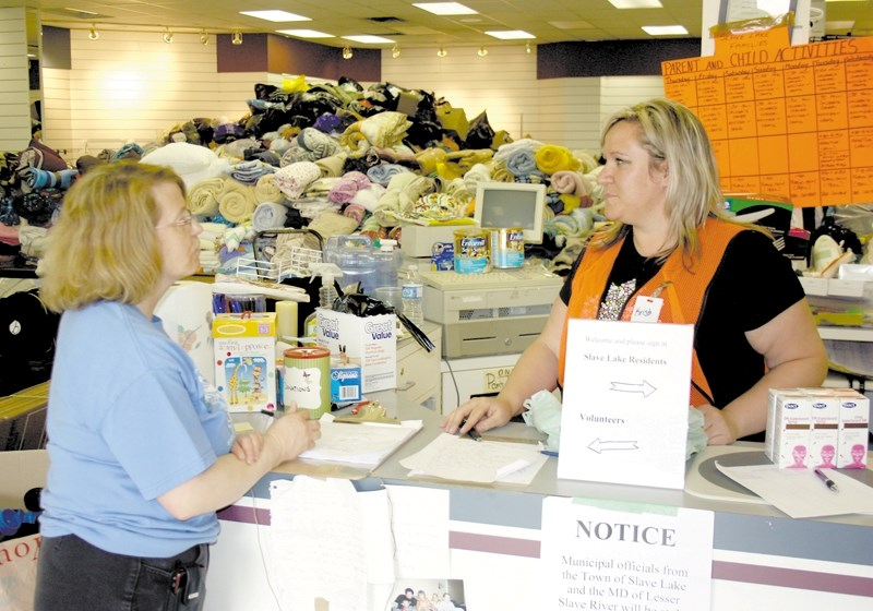 The community has been generous with support for the Slave Lake evacuees who have found themselves in Westlock. Above, a mountain of donations can be seen as volunteers Paddy