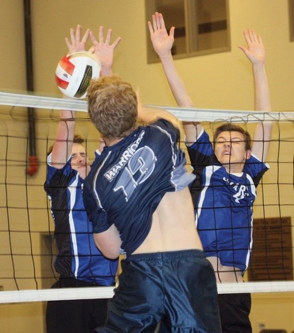 Sharks Carson Boulerice and Dylan Magus put up a block against Living Waters Nov. 16.