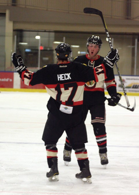 Warriors Taylor Heck and Scott Westerlund celebrate after Heck potted his first of two goals in the second period during the Warriors 5-2 victory over the Red Deer Rustlers Nov. 1 at the Rotary Spirit Centre.