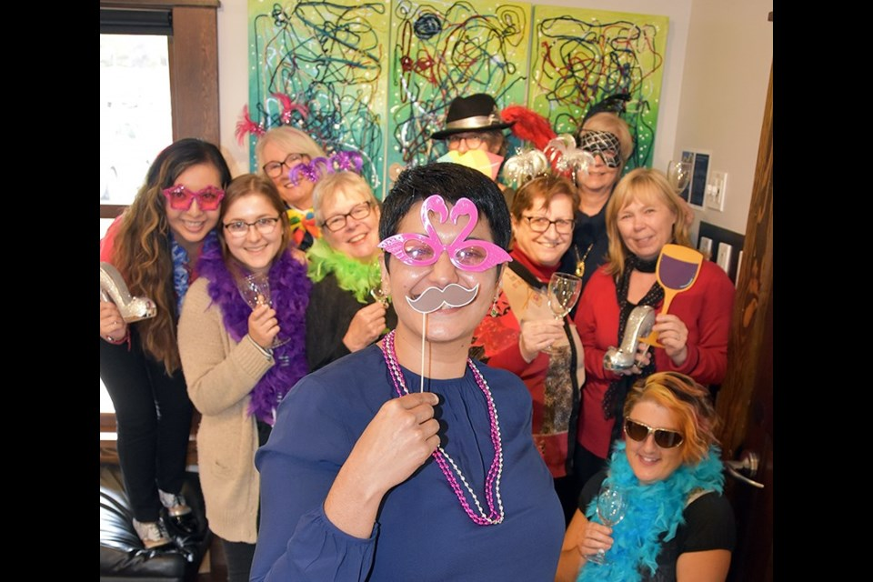 Fatima Amarshi (at front), the managing director of PoMoArts, with staff and volunteers at the Port Moody arts hub in 2018 as they promoted the Girls Night Out fundraiser.