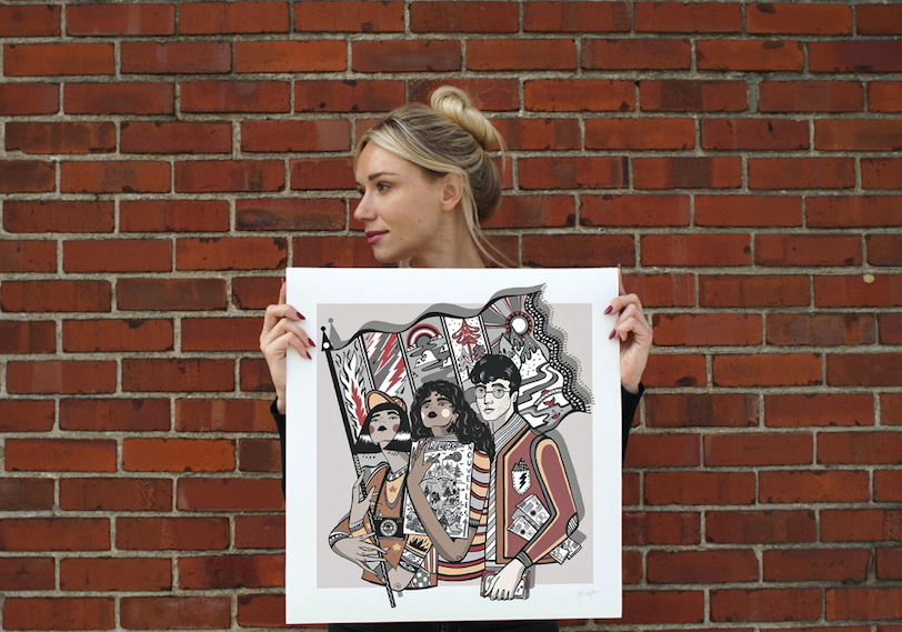 Ola Volo with her Champion The Truth limited edition print for sale during  National Newspaper Week (Oct. 3-9, 2021)