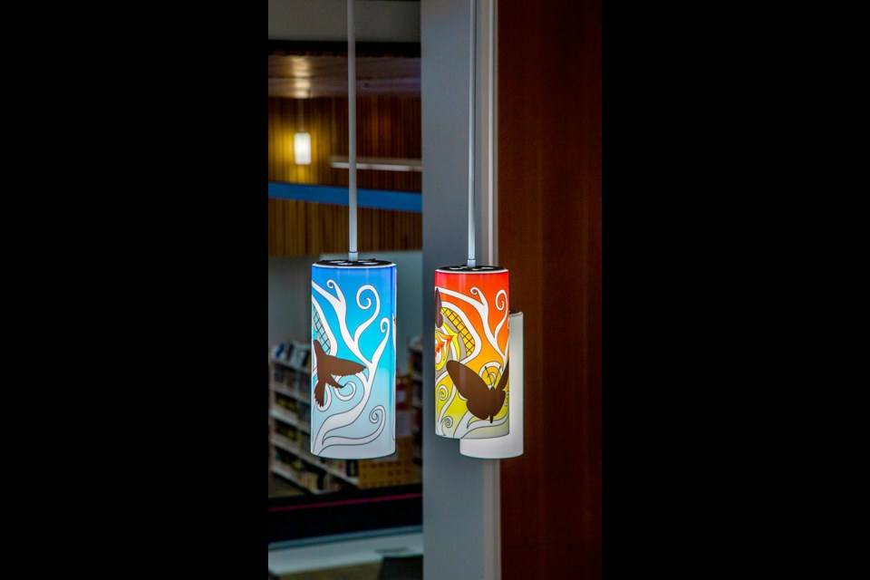 Katzie First Nation artist Rain Pierre (sɬə́məxʷ) — in collaboration with Dusty Yurkin — designed the lamp coverings for the City Centre branch of the Coquitlam Public Library.
