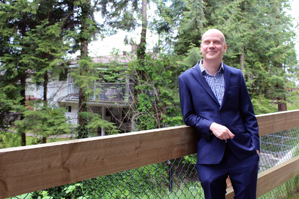 """Demian Rueter, a senior planner with the city of Coquitlam who is leading the Southwest Coquitlam Housing Review, at the northeast entrance to Brookmere Park — close to the Austin Creek tributary. The watercourse is a key feature for a proposed """"green link"""" in the Whiting-Appian neighbourhood pocket, where the city is eyeing more growth over the next few years. If approved, the green link would connect the future YMCA with Brookmere Park in Burquitlam."""