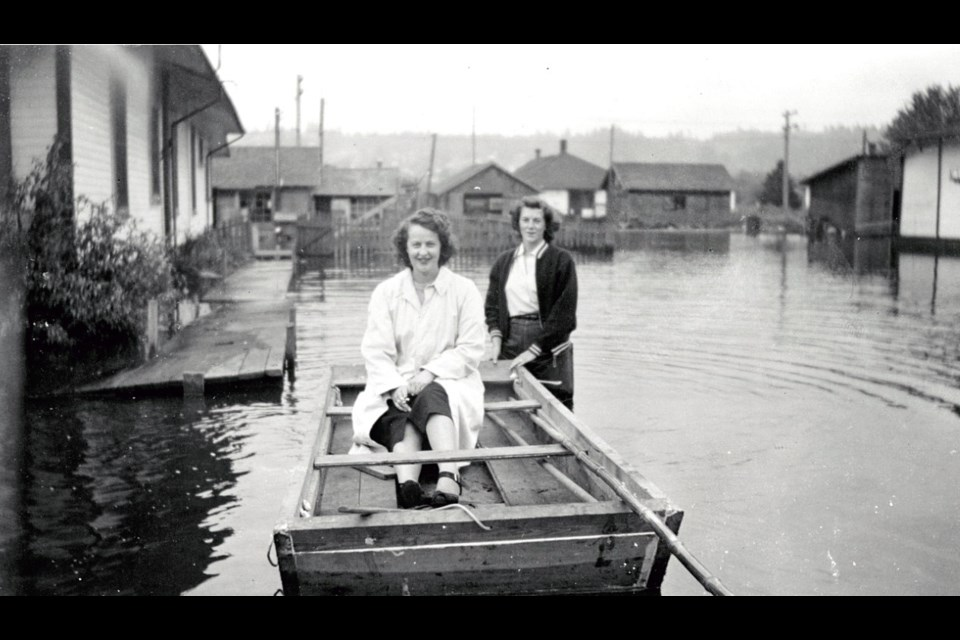 Kay Martin and Rosa Marie Crandell in a makeshift boat in Coquitlam, during the flood of 1948.