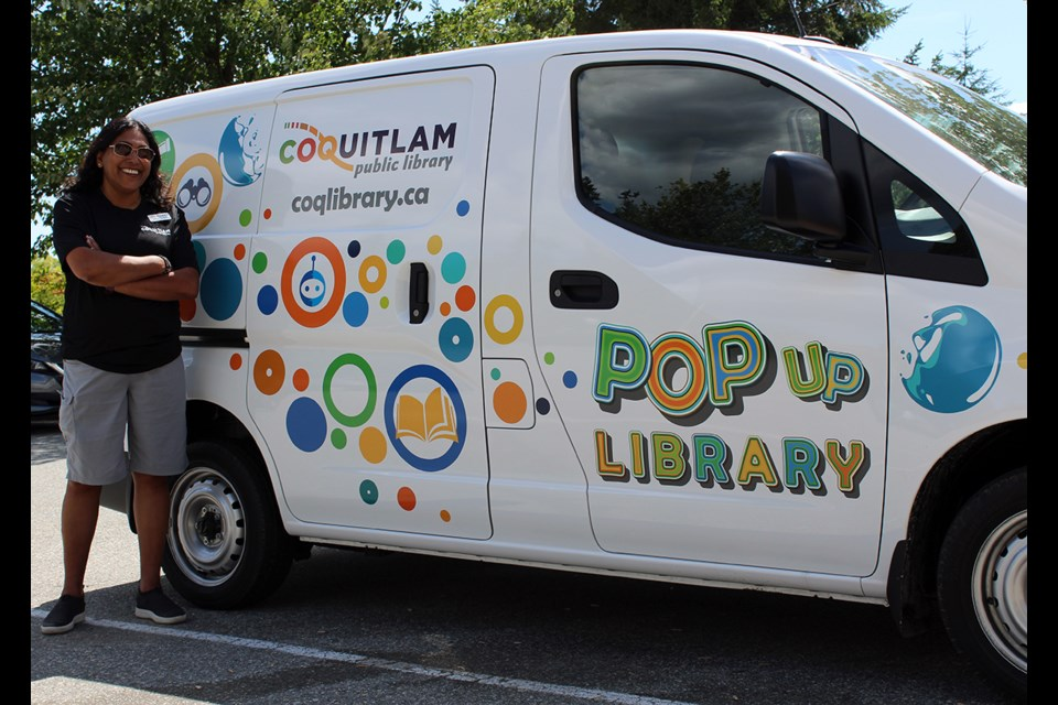 Ann Johannes, the Coquitlam Public Library's community development liaison for programming and community connections, with the POP van.