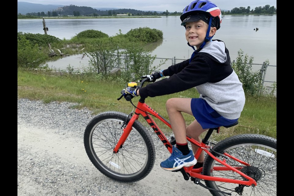 Cycling the gravel paths on the top of Coquitlam and Port Coquitlam dikes is a fun activity for the family.