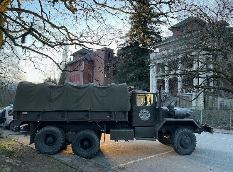 Military vehicles are used as props outside Centre Lawn at səmiq̓wəʔelə, formerly the Riverview Hospital.