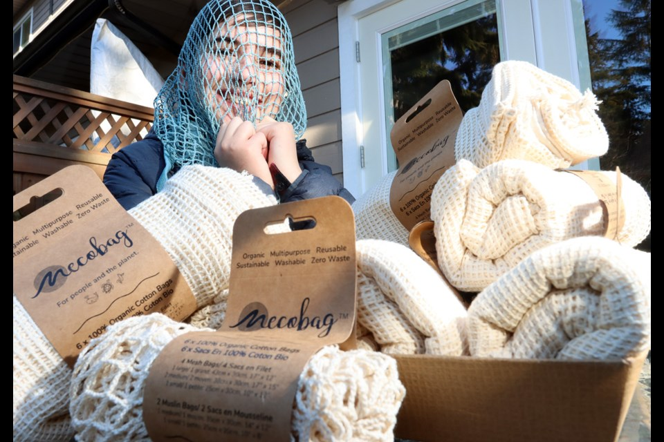 Paxton Moore, 12, has started his own business selling and distributing organic cotton shopping bags.