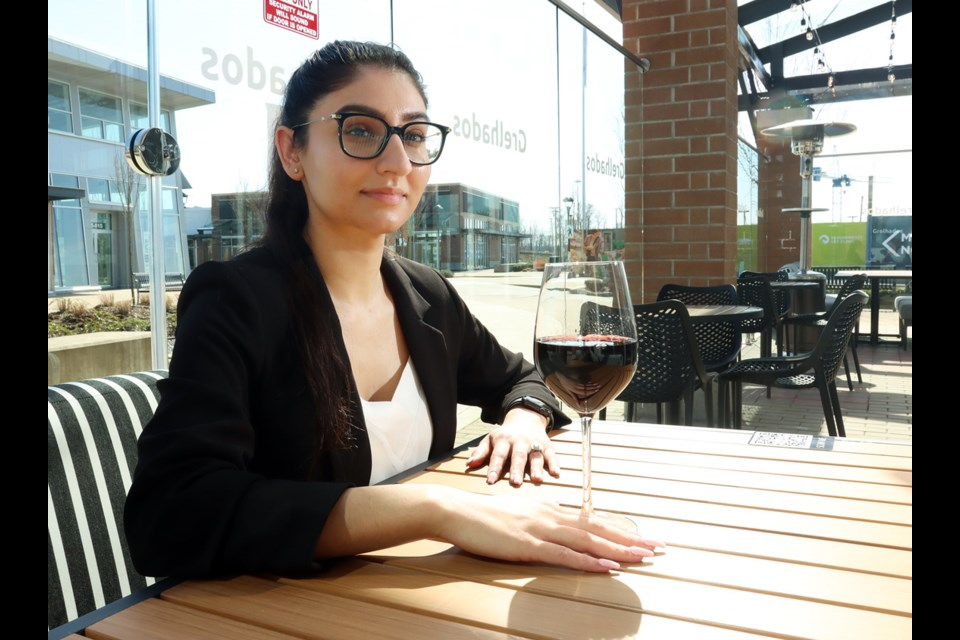 Tanpreet Sandhu, the general manager of Grelhados Grill and Bar restaurant in Port Coquitlam takes a break on the deserted patio. The restaurant's owner, Peter Sandhu, said the establishment was just finding its feet when new public health restrictions closed its dining room.