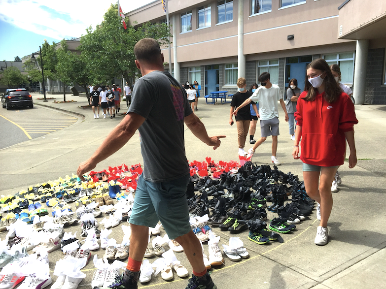 Students in Mike Gosselin's Grade 10 social studies class visit a medicine wheel display out front of Riverside Secondary in Port Coquitlam as part of a commemoration of the 215 children whose remains were found outside a Kamloops residential school.
