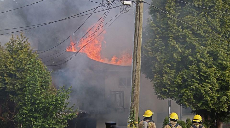 Coquitlam firefighters battle the flames of a Therrien Street home blaze near Brunette Avenue on June 10, 2021.
