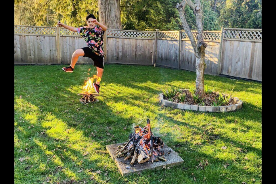 Majid Davoudi, 14, jumps over a fire at his home in North Vancouver. The practice honours nature, celebrates the rejuvenation of spring and is meant to cleanse the jumper of bad habits, says Coquitlam friend of the Davoudi family Behzad Abdi.