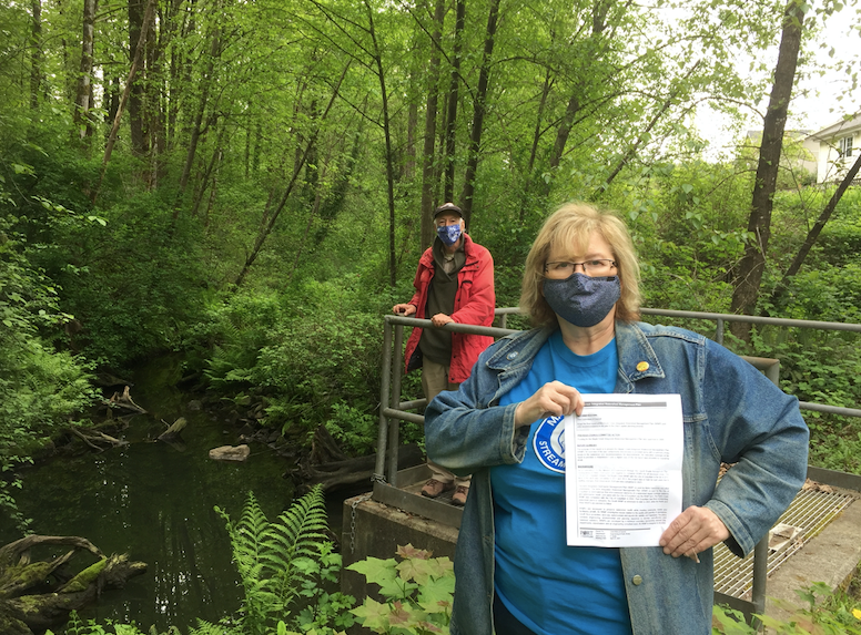 Sandy Budd and Jeff Rudd, of the Maple Creek streamkeepers in Port Coquitlam, are happy with a plan to improve the creek but wonder why it took so long.