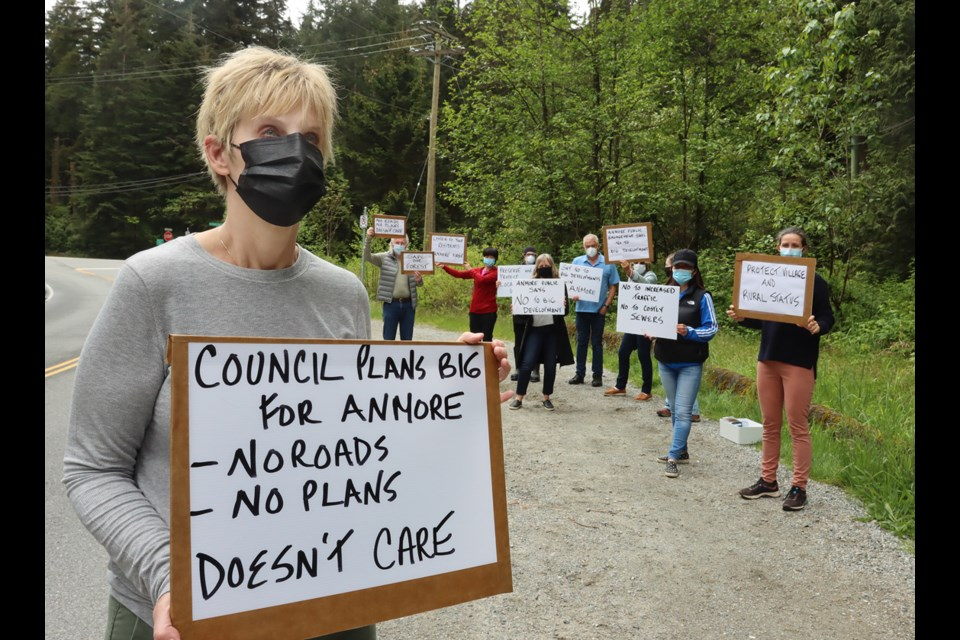 Meralee Guidi leads a contingent of Anmore residents opposed to a plan to redesignate a portion of the village from rural to urban.