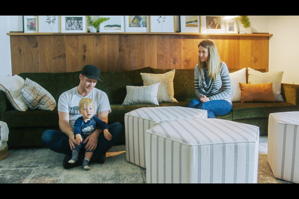 Kaela Scott, Matthew DeGelder and their son, Beckett, relax in the basement of their Port Moody home that received a room makeover for a YouTube series.