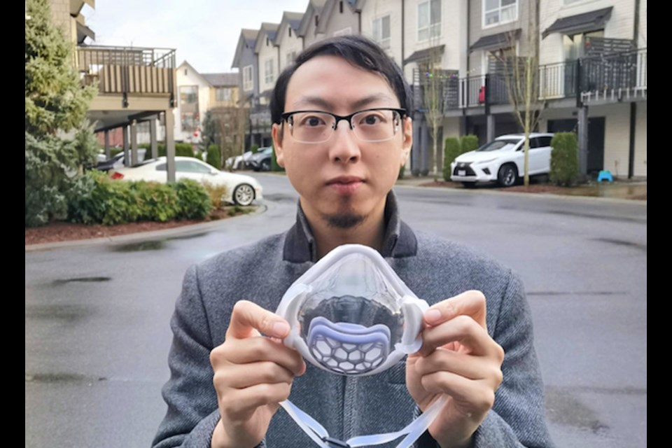 Yat Li with one of the clear masks he developed to promote communication for people who are deaf or hard of hearing.