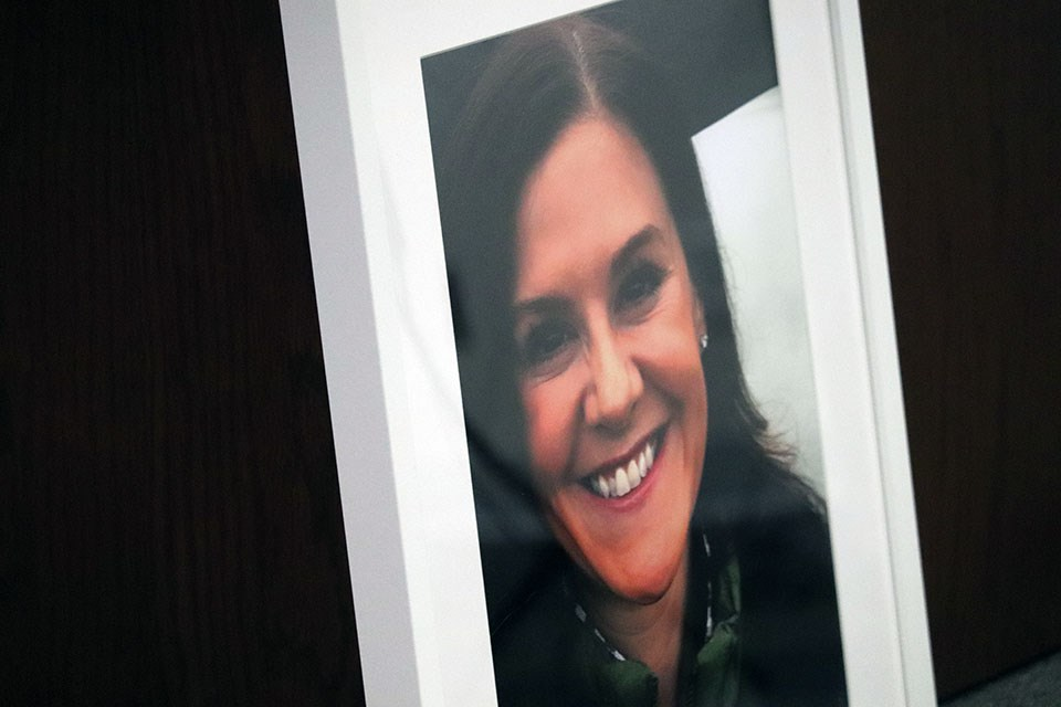 A photo of Trina Hunt sits at a podium as the Port Moody woman's murder is still under investigation by the Integrated Homicide Investigation team as of June 1, 2021.