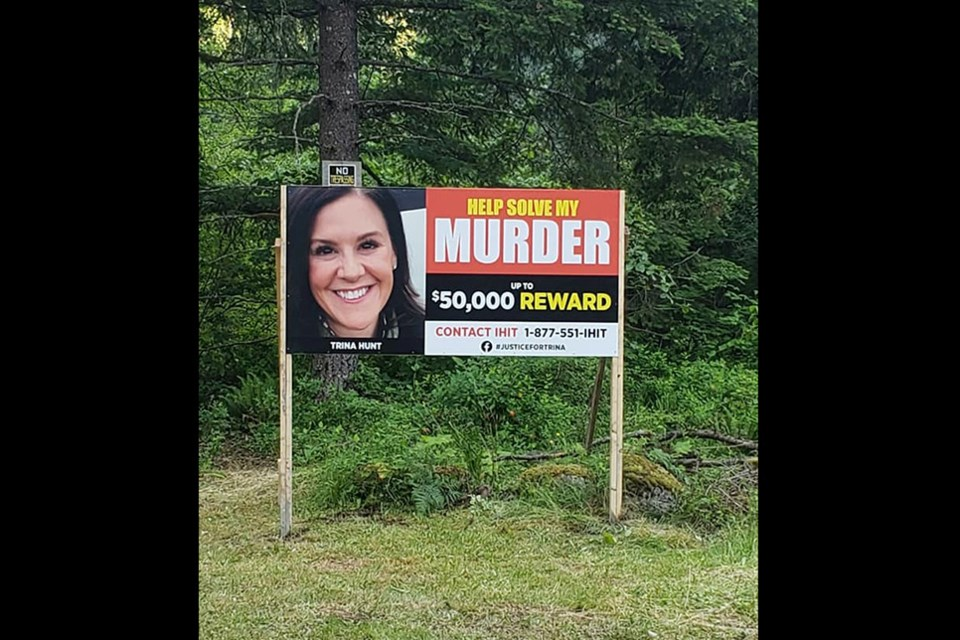 A large sign asking passersby to call for information on Trina Hunt's murder has been placed in the Silver Creek area south of Hope where the Port Moody woman's body was found on March 29, 2021.