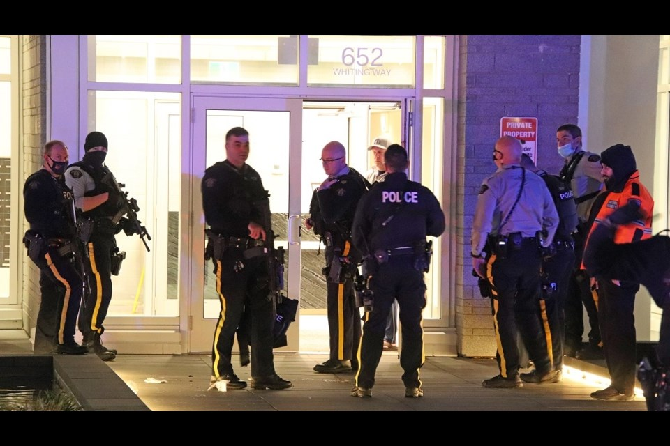 A massive police response, including the heavily armed RCMP Emergency Response Unit, outside a Burquitlam condo complex after reports a woman was shot and left bloodied on the lobby floor.