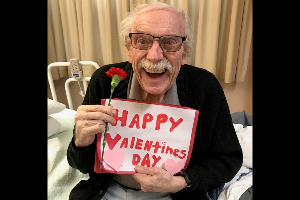 A Valentine's Day Card made by a School District 43 student puts a smile on the face of a resident of Dufferin Care Centre in Coquitlam.