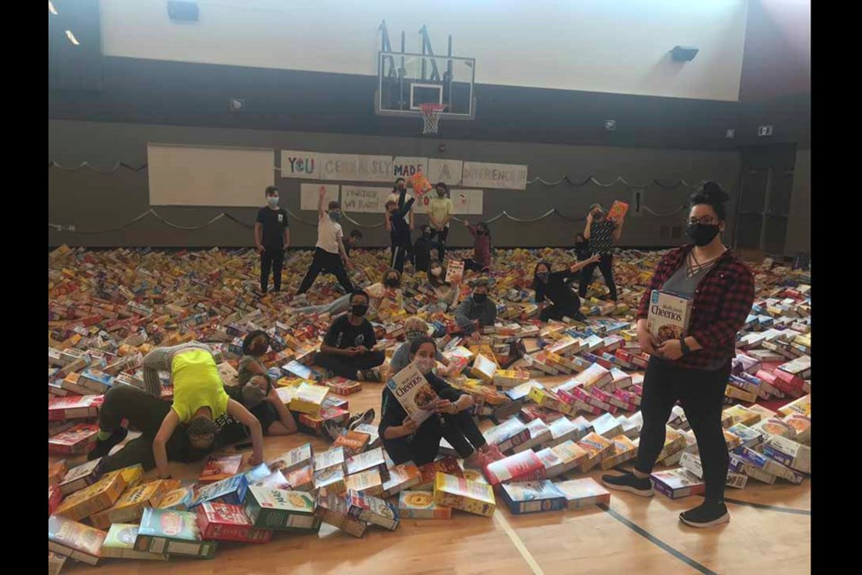 École Banting Middle School teacher Tiana Chan (right) organized a first-of-its-kind fundraiser that saw students collectmore than 2,000 cereal boxes for SHARE Food Bank.