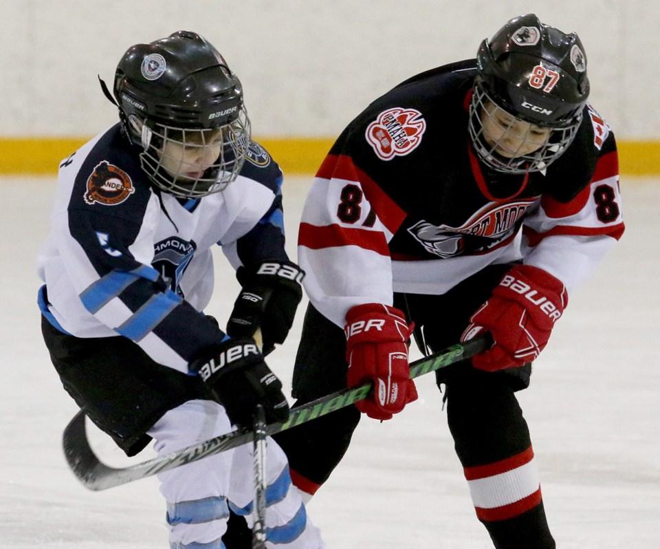 0223-PoMoHockeyCOVIDFile 1w