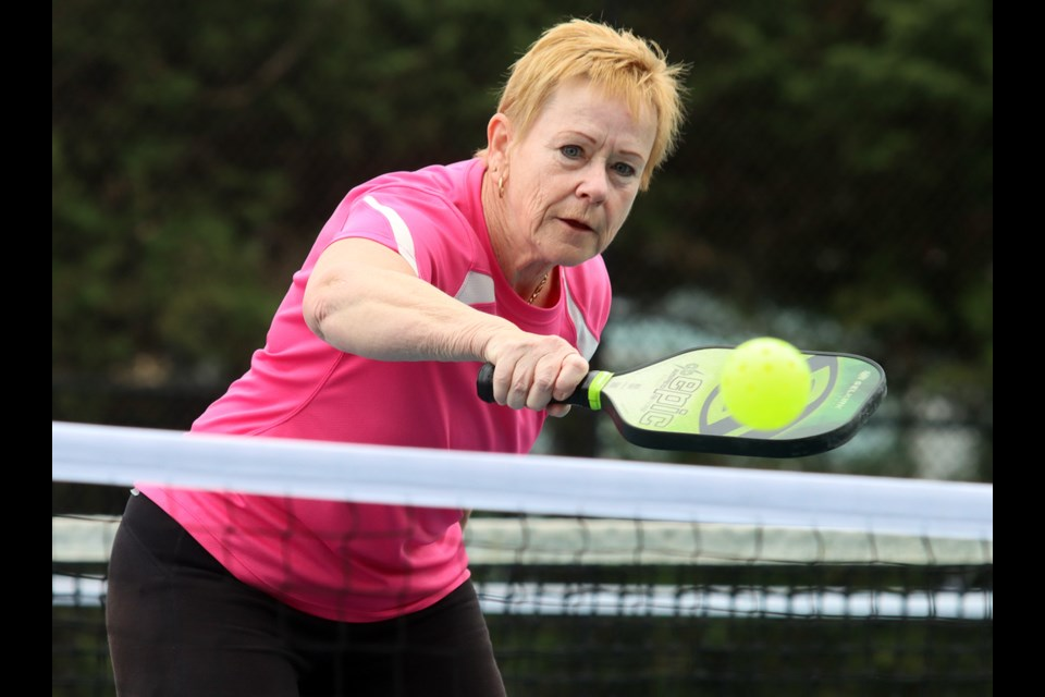 Barbara Dueck returns a backhand volley during a pickleball match at the courts near Dogwood Pavillion in Coquitlam on Friday.