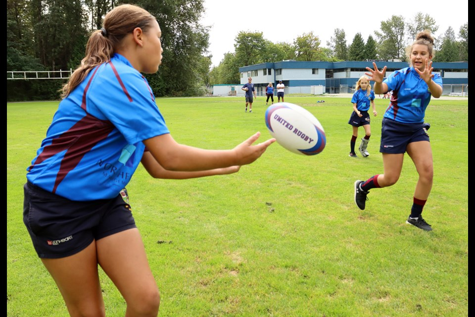 Players in United rugby club's girls program work on a passing drill at Maple Creek middle school in Port Coquitlam.