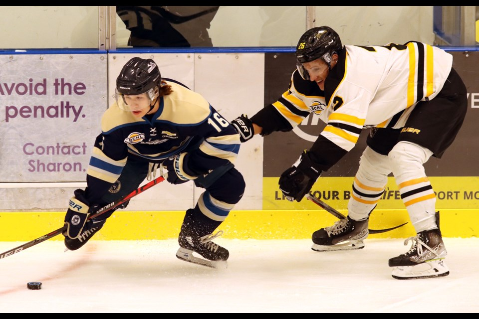 Langley Rivermen forward Owen Kim tries to escape the checking of Coquitlam Express defenceman Lucas Lundy in the first period of their BC Hockey League pre-season game, Wednesday at the Poirier Sport and Leisure Complex.