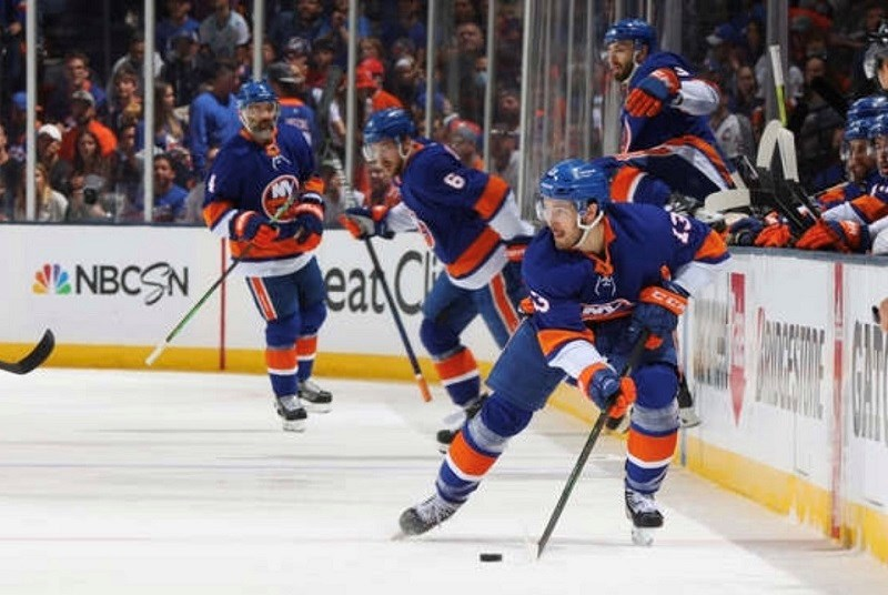 Coquitlam's Mathew Barzal (#13) skates with the puck for the New York Islanders during the 2021 NHL semi-finals against Tampa Bay.