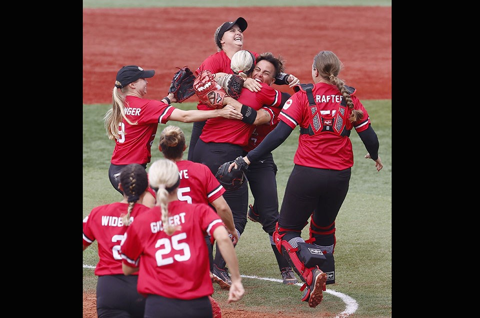 Port Coquitlam's Jenn Salling (#7) is embraced by her teammates after Canada claimed the bronze medal in a 3-2 win over Mexico at the Tokyo 2020 Olympics.