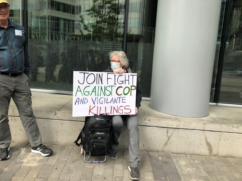blm protest cop sign by elana