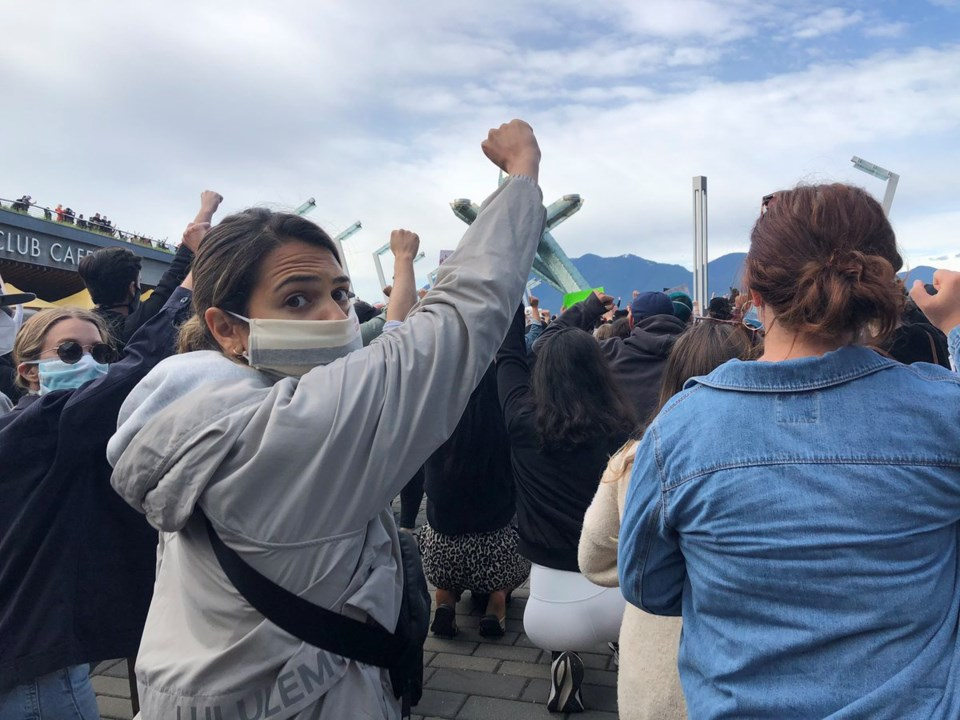 blm protest vancouver crowd takes a knee by elana