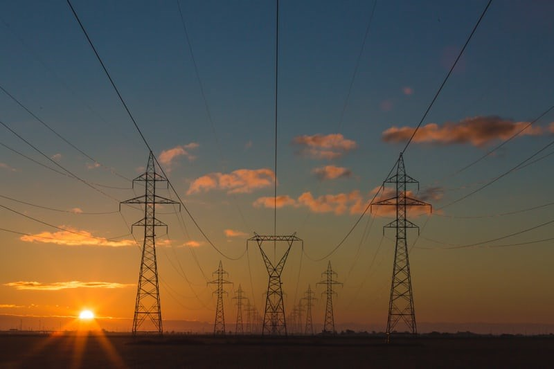 electricity transmission towers photo-1473341304170-971dccb5ac1e