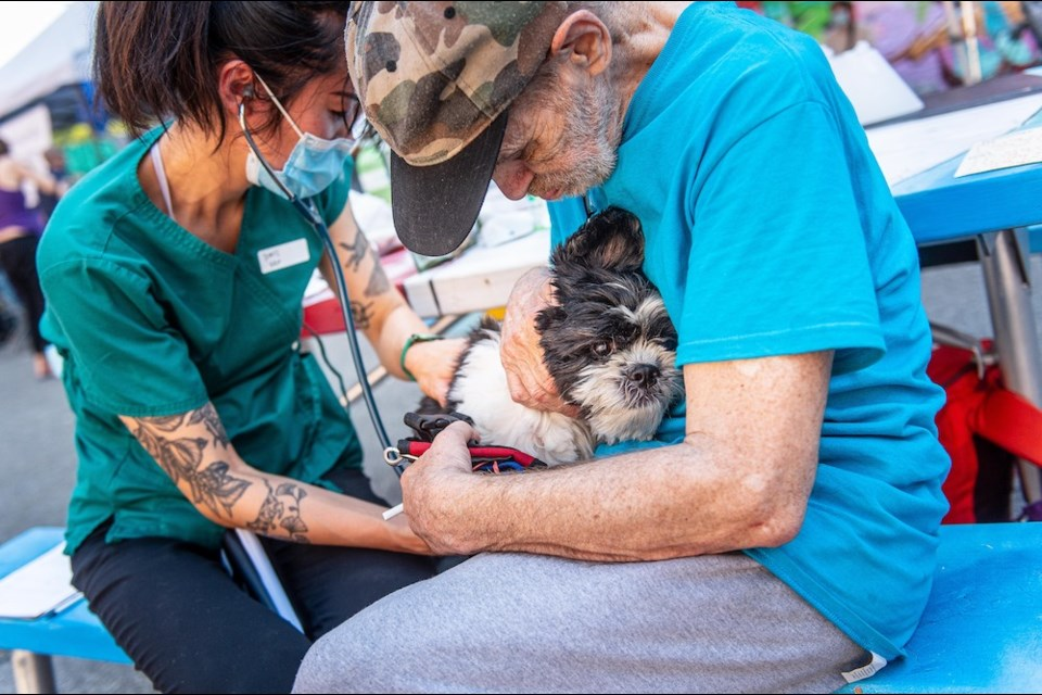 Dr. Doris Leung supporting Ozzie the dog at the Pet Fair People Care Event in June 2021.