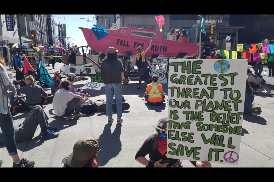 Protestors from Extinction Rebellion's Vancouver chapter gathered at the intersection of Georgia and Granville streets on Saturday, May 1 to urge action in the face of a climate emergency.