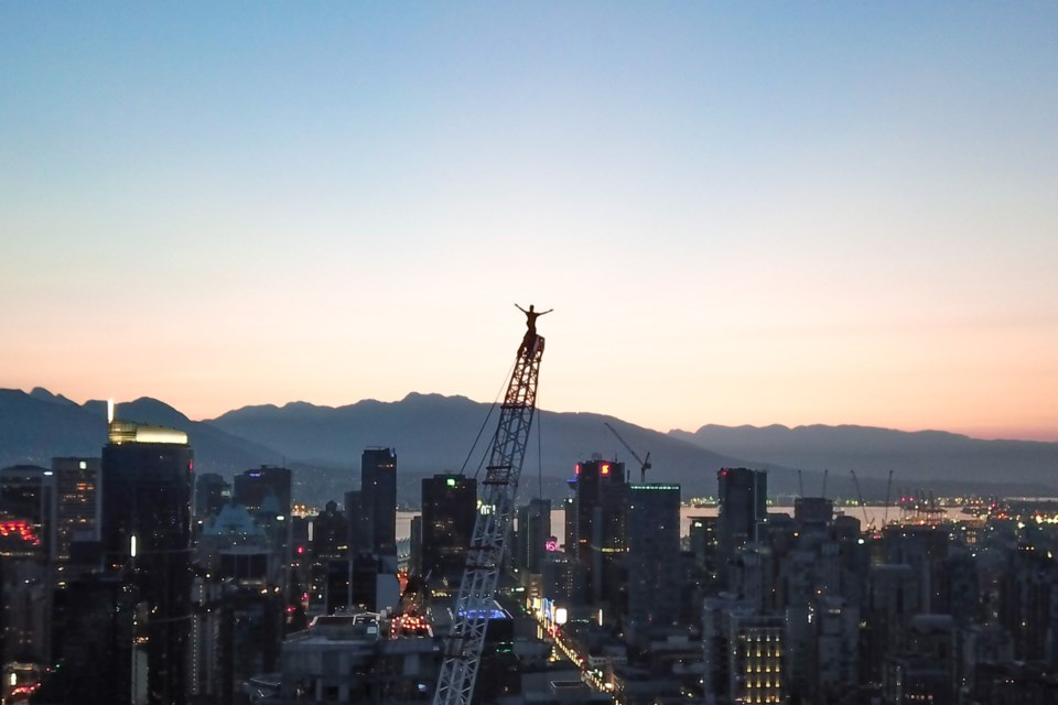 """Chase described a Vancouver crane he clambered up one morning as """"sketchy"""" and  """"miserably large"""" but that didn't stop him from getting to the very top."""