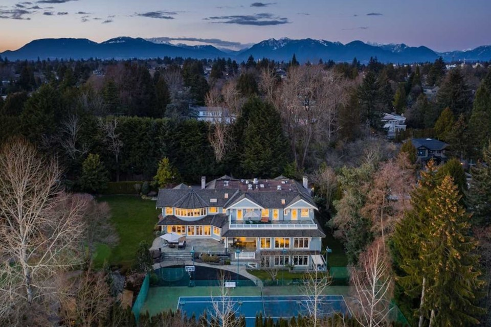 Complete with eight bedrooms and 12 bathrooms, a massive home located on W 55th Avenue sits on a 1.052-acre estate on Vancouver's West Side.