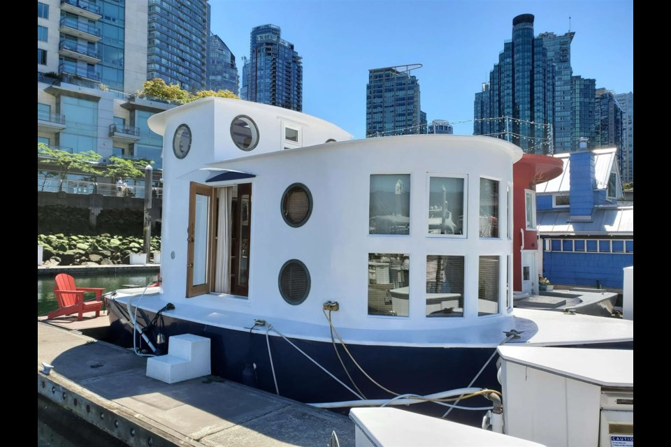 The floating home is docked in Coal Harbour in downtown Vancouver.