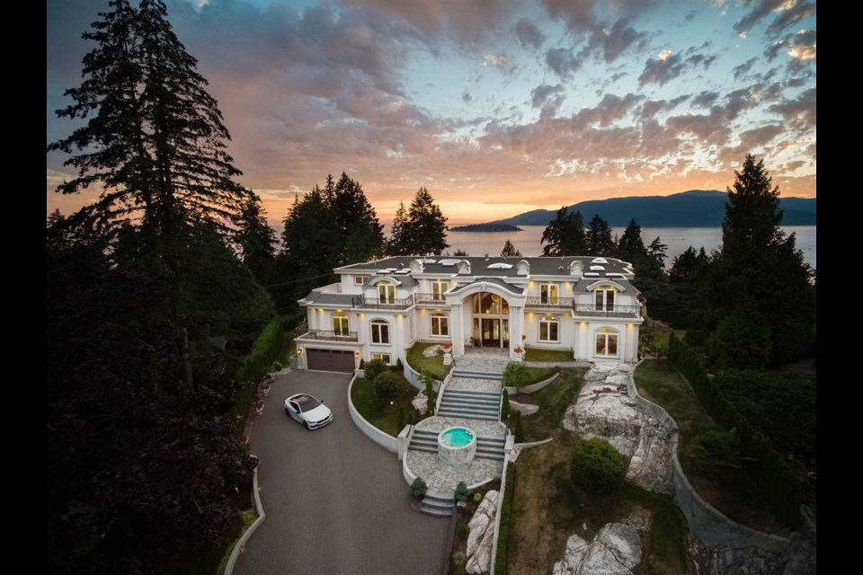 This $22.8 million West Vancouver mansion includes a massive chandelier, outdoor pool with a view and wine cellar.